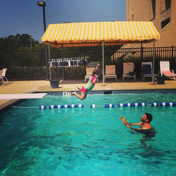 Brian catching Emily at the pool